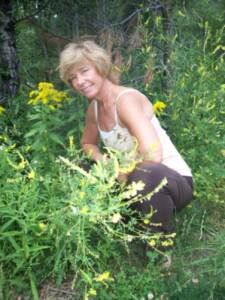 Susan crouched in a thicket of Goldenrod